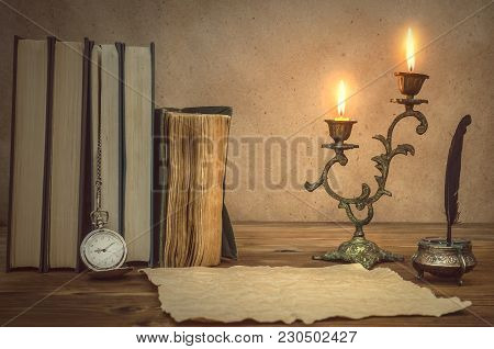 The Old Letter. Old Books Feather Pen In Inkpot, Blank Paper Page Sheet And Retro Pocket Watch On Re