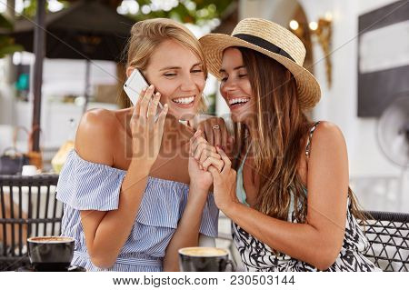 Portrait Of Of Beautiful Female In Summer Blouse, Speaks Via Cell Phone, Happy To Hear Someone, Keep