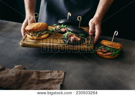 Man Holding Set Burger Beef Medium Rare Spinach Sauce