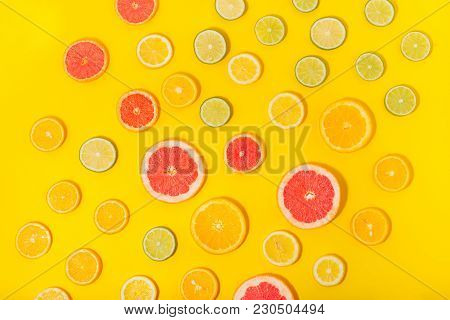 Overhead View Sliced Citrus Fruit Yellow Background Flat Lay