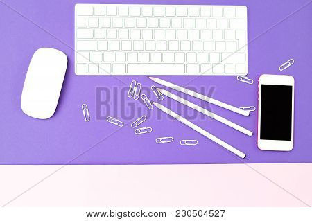 White Keyboard And White Stationery On The Ultra Violet Background. Flat Lay