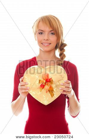 Young Woman With Gold Gift Box As Heart In Hands