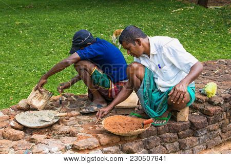 SIGIRIYA, SRI LANKA- DEC 26, 2016: Unidentified people reconstruct the wall of Sigiriya ruins on Dec 26, 2016, Sri Lanka.