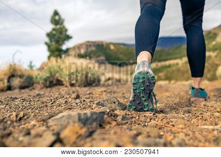 Sole Of Sports Shoe Walking In Mountains On Rocky Path. Cross Country Runner Training In Inspiring N