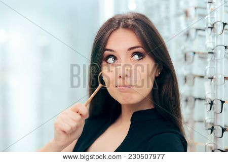 Woman Looking To Replace Old Lorgnette Glasses With New Pair