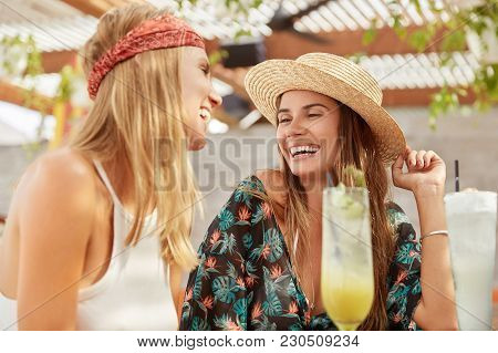 Joyful Female Lesbians Recreat Together In Tropical Country, Spend Free Time At Outdoor Terrace Bar
