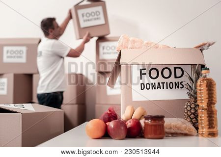 Collect This. Close Up Of Food Donation That Being Ready For Packaging, Lying On The Table
