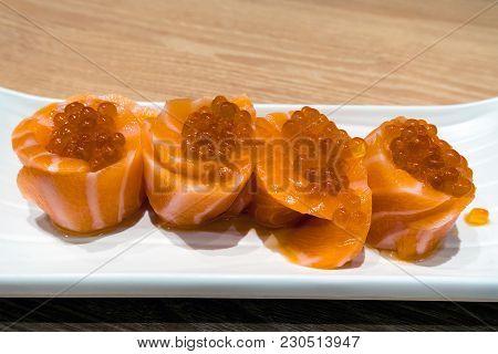 Fresh Raw Salmon Fish Sushi Roll With Salmon Roe On White Ceramic Plate Closeup Macro