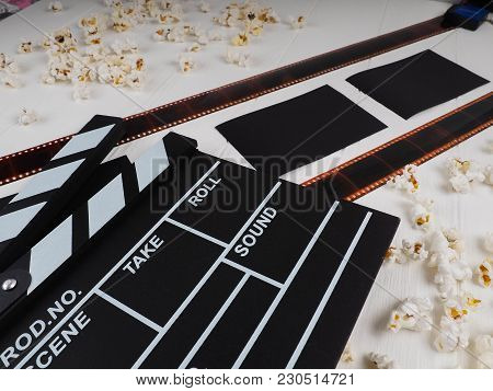 Movie Reel On A Wooden Background, Reel On A Wooden Background