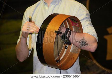 Genoa Italy - March 9 2018: An Irish Drum Player (bodharan) Of The Kilkennys Group At The Irish Fest