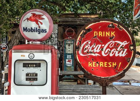 Hackberry, Arizona, Usa - May 19, 2016 : Retro Gas Pump And A Rusty Coca-cola Sign  On Historic Rout