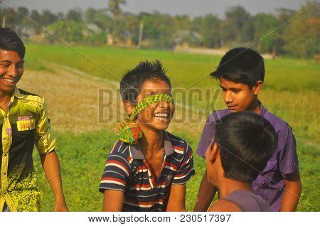 Dhaka, Bangladesh, 11 March 2018: The Rural Boys Of Bangladesh Are Playing The Local Game Name Kanam