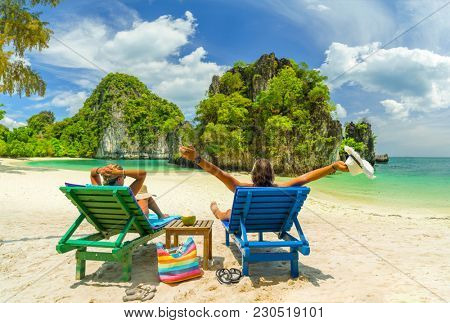 Couple on the beach at tropical resort Travel