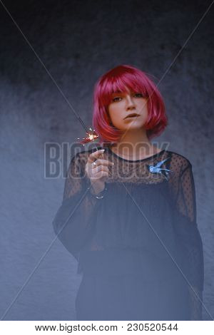 A Wonderful Woman With Pink Hair, Wearing A Wig, Holding In Her Hands Bengal Lights. Half A Face Cov