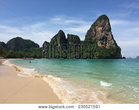 Ao Nang Beach In Southern Thailand Showing Rock Formations And Tranquil Blue Water At A Popular Tour