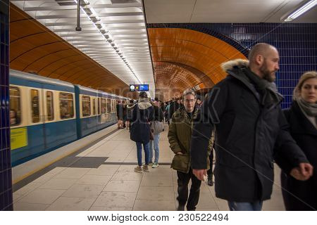 Munich,germany-march 10,2018 : Passengers Leave The Train Platform After Disembarking From A Subway
