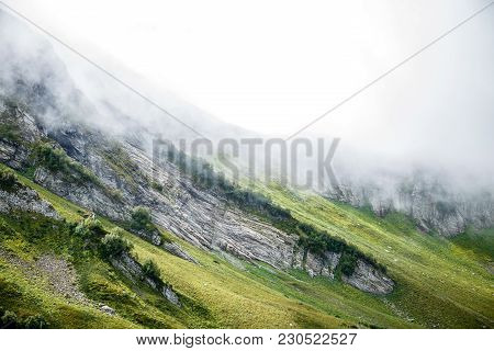 Image Of Misty Hilly Terrain On Summer Day