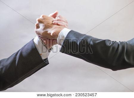 Two Businessmen Partner To Greet Each Other, A Firm Handshake