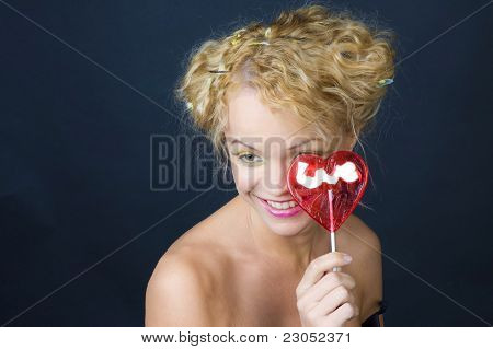 Portrait of a funny girl with candy