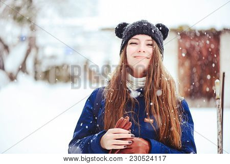 Winter Portrait Of A Young Woman. Beauty Joyous Model A Girl Laughs And Is Happy To Have A Winter Ba