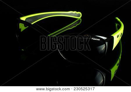 Stylish Sunglasses Isolated On The Dark Background