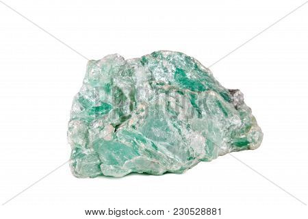 Macro Shooting Of Natural Gemstone. The Raw Mineral Is Talc. Isolated Object On A White Background