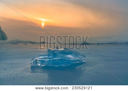 Ice On Freezing Baikal Water Lake With Sunlight Sky Background, Siberia Russia Winter Season Natural