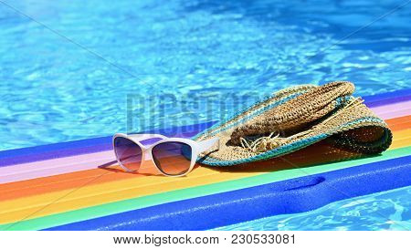 Sunglasses, Lilo And Hat On The Water In Hot Sunny Day. Summer Background For Traveling And Vacation