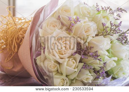 Beautiful Sweet White Roses Bouquet In Vintage Tones Style. Luxury Romantic Gift Or The Present On V