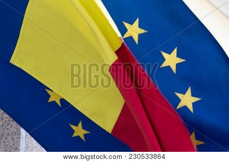 Close-up View Of The Romanian And European Union Flags