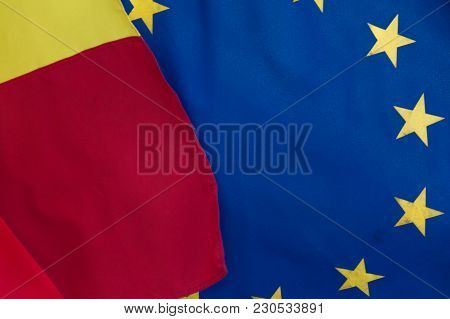 Close-up View Of The Flags Of The Romania And European Union