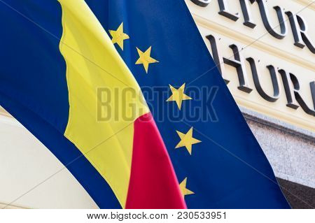 Romanian And European Union Flags Are Wawing In The Breeze