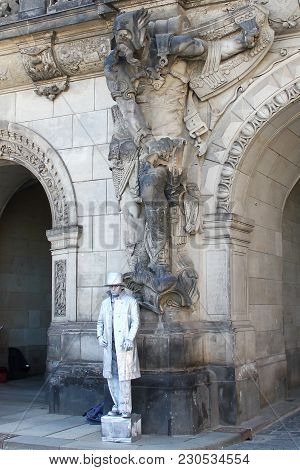 Dresden, Germany - April 27, 2014:this A Mythical Sculpture And Streen Artist Who Are Neighbors At A