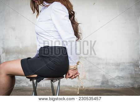 Woman's Hands Tied With Rope