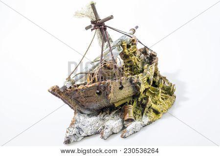 Aquarium Accessories Boat In A White Backgorund Composition