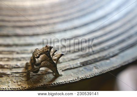 Three Frogs On Surface Of Ancient Bronze Drum. Frog Drum Or Rain Drum In Thailand