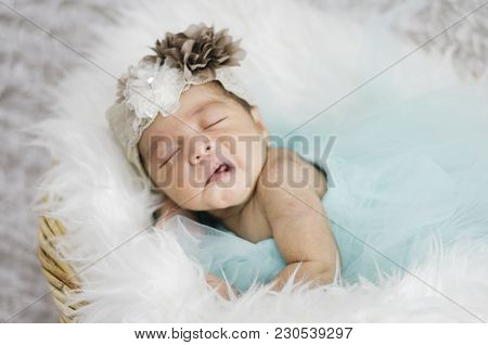 Portrait Of Cute And Adorable Newborn Baby With Head Band Sleeping In Basket.new Life And Parenting