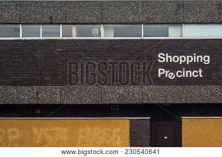 Recession Image Of A 1970s Style Grim Urban Rundown British Shopping Precinct Sign