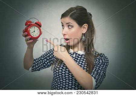Overslept Shocked Woman Holding In Hand A Red Alarm Clock. Be Late At Work Or School. Oversleep. Lat