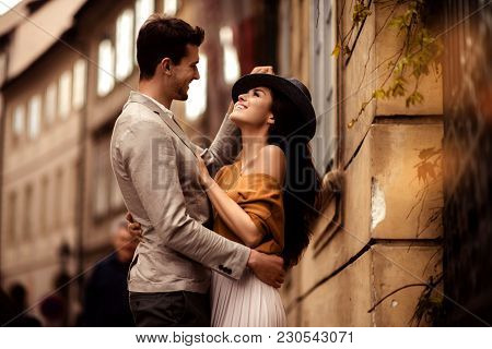 Passionate Gorgeous Young Couple Embrace Each Other While Walk Across Ancient City. Cheerful Elegant