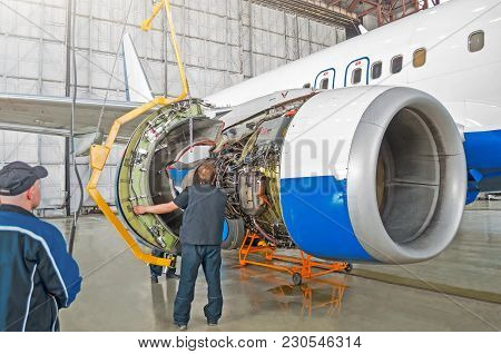 Assembling, Replacing Engine Parts Of The Aircraft After Repair. Specialist Mechanic Controls The Cr