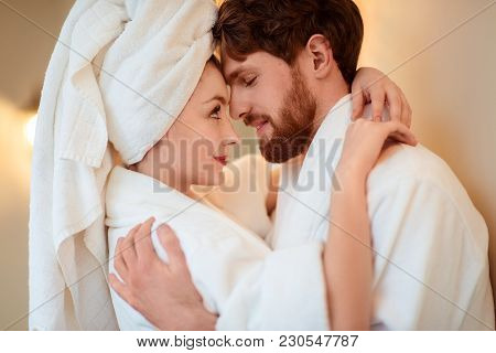 Close Up Shot Of Beautiful Woman And Her Husband Cuddle Each Other, Express Love, Wear Comfortable B