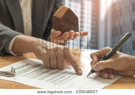 Real Estate Trading Concepts,home Brokers And Buyers Signing A Sale Contract.