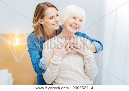 Family Love. Pleasant Cute Young Woman Feeling Happy While Standing Behind The Back Of Her Positive