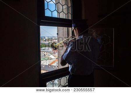 Krakow, Poland - May 29, 2016: The Trumpeter In The St. Mary's Basilica Performs The Mariacki Hejnal