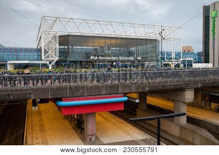 Amsterdam, Netherlands - June 25, 2017: Amsterdam Sloterdijk Station With Bikes Parking On The Foreg