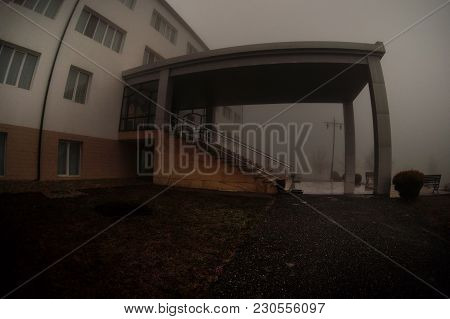 Old House With A Ghost In The Forest At Night Or Abandoned Haunted Horror House In Fog. Old Mystic B