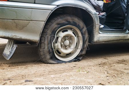 Car Flat Tire On A Bad Road Need To Repair
