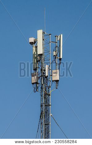Cellphone Tower On A Blue Background. A Communications Tower.