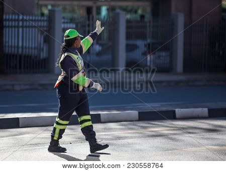 Johannesburg, South Africa - March 8, 2018: Traffic Officer Holding Hand Up To Traffic.